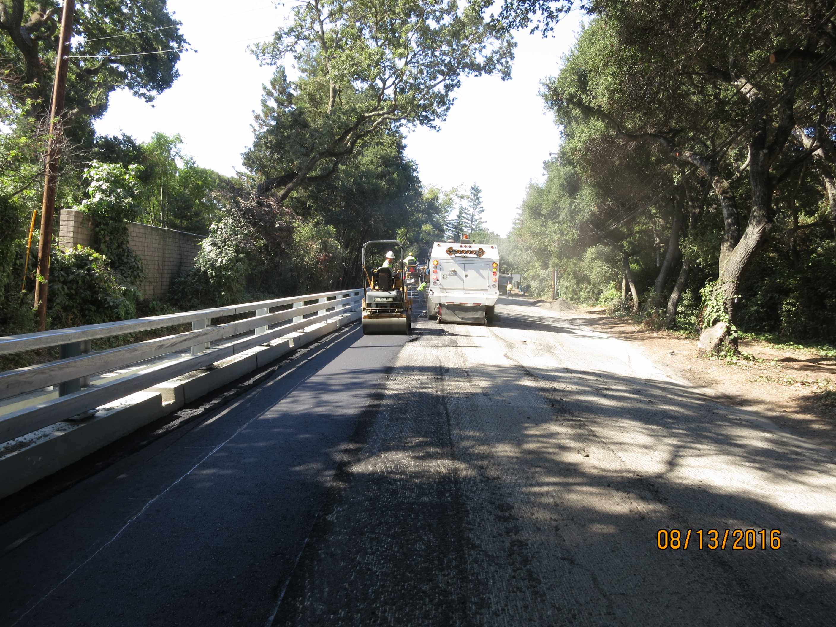 Paving near guardrail